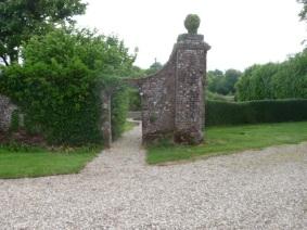 Gatepier next to sunken garden
